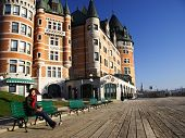 Tourist on Terrasse Dufferin in front of Chateau Frontenac - The most famous landmark in Quebec City. poster