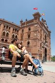 Madrid. Happy couple travelling in Spain, in front of the bullfighting arena Plaza de Toros de Las V