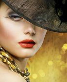 stock photo of beautiful lady  - Beautiful Lady over luxury gold background - JPG