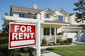 stock photo of house rent  - Right Facing Red For Rent Real Estate Sign in Front of Beautiful House - JPG