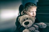 Sad Little Girl Embracing Her Teddy Bear - Feels Lonely poster