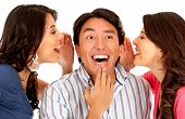 Women telling a secret to a surprised man - isolated over white