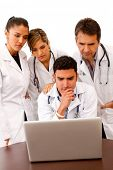 stock photo of computer technology  - Group of doctors with a computer  - JPG