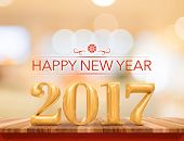 Happy New Year 2017 (3D Rendering) New Year On Wood Plank Table Top With Blur Abstract Bokeh Backgro poster
