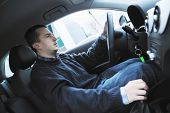 young man using new car navigation and onboard vehicle transport system