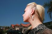 Beautiful young woman outdoors over clear blue sky.