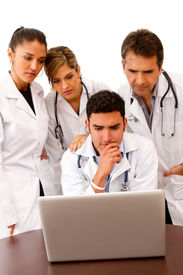 picture of computer technology  - Group of doctors with a computer  - JPG