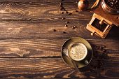 Wooden Background With Green Cup Of Coffee, Beans And Coffee Grinder. Top View. Retro Style Toned Da poster