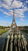 View Of The Eiffel Tower With Blue Sky And Clouds And Old Cannons  From The Trocadero In Paris Franc poster