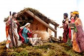 Christmas Nativity Scene With Holy Family In The Hut And The Three Wise Men, Isolated On White Backg poster