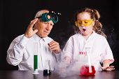 The Process Of Chemical Experiments. Girl Doing A Chemical Experiment poster