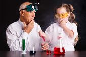 Chemical Experiments In The Laboratory.girl Doing A Chemical Experiment poster