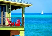 Colorful Balcony Over Emerald Seas