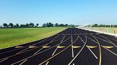Eight Lane Black Asphalt Running Track In Stadium Black And White. Running Track On Blue Sky. Runnin poster