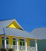Lemon and Lime colored coastal home with tin roof