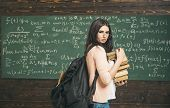 Side View Young Student Preparing For Exam With Heap Of Math Books In Classroom. Beautiful College G poster