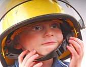 Young Boy Wearing Fireman's Helmet