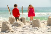 Brother and Sister at the Beach, Building Sand Castles