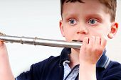 Young boy trying to play flute