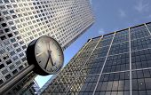 Clock And Office Buildings poster