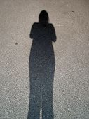 A Shadow Of A Young Woman