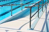 Handicap ramp leading into community swimming pool