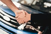 Customer And Buyer Are Shaking Each Other Hands. Automobile Salon. Make A Decision. End Of A Deal. G poster