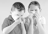 stock photo of snot  - Young girl and boy blowing noses with cold - JPG