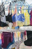 Womens Panties On The Hanger In The Store. Lingerie In The Store. New Lace Lingerie. Vertical Photo poster