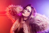 Trendy Girl Dancing In A Fluffy Pink Coat. Disco Neon Light, Fashionable Pink Fur Coat. Sci-fi Fashi poster