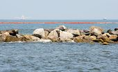 PERDIDO PASS, FL- JUNE 8: Oil boom is placed by a rock jetty in Peridido Pass, FL on June 8, 2010 as