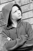 girl in hooded jacket outside