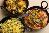 Lamb korma curry with aloo gobi and pilau rice.