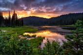 Scenic View Of Mount Rainier Reflected Across The Reflection Lakes At Sunset poster