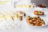 Solemn Happy New Year Banquet. Lot Of Glasses Champagne Or Wine On The Table In Restaurant. Buffet T poster