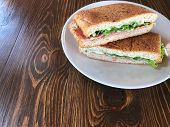 Top View On Fresh Sandwich, Tuna And Ham Sandwich In The White Dish On The Wooden Table With Natural poster