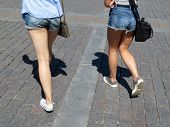 Two Girls In Denim Mini Shorts Walking On The Street. Hurrying Women, Casual Style, Hot Weather, Bea poster