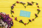 Love You Concept With Flowers, Flat Lay. Statice Limonium Flowers Forming Heart Shape And Paper With poster