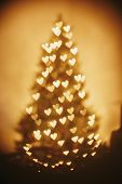 Beautiful Christmas Tree Golden Lights Hearts In Festive Room. Christmas Abstract Background, Blur D poster