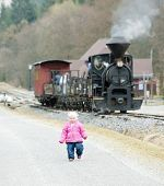 litte girl and steam train, Ciernohronska Railway, Slovakia