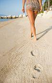 Nalgas de la mujer en la playa Tropical