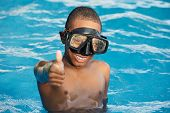 Black boy with glasses in the swimming pool