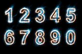 set of glowing electric numbers