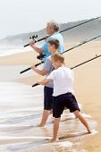 image of grandpa  - grandpa took his grandsons fishing on beach - JPG