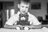 Funny And Naughty Caucasian Child With A Toy Teddy Bear. Happy Childhood Concept. Black And White Im poster