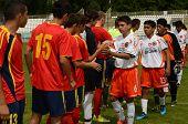 KAPOSVAR, HUNGARY - JULY 21: Competitors shake hands  at the VIII. Youth Football Festival U16 Final Munincipal Pozo Almonte (CHI) vs. FC Makedonija (MKD) July 21, 2012 in Kaposvar, Hungary