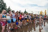 MOSCOW - JULY 14: Young people ready for shooting and throwing water at each other during flash mob