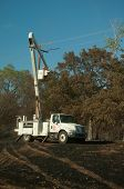 CREEK COUNTY, OKLAHOMA - AUGUST 6 2012: crews restoring power after a massive wildfire  on August 6,