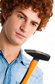 Young man holding an hammer