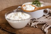 cottage cheese in a plate and a spoon with cottage cheese